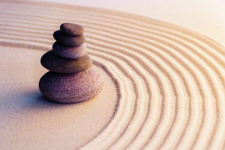 Meditation zen garden with stones on sand